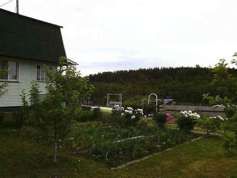 Жилой дом у озера в Березинском биосферном заповеднике. Фото