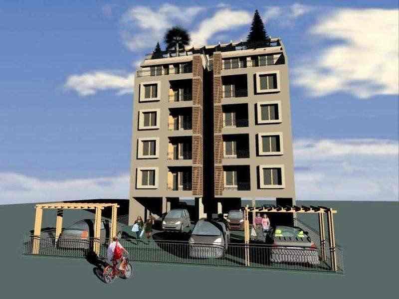 Строящийся жилой дом расположен недалеко от моря.
